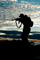 silhouette of a soldier aiming a rifle