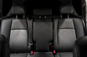Back passenger leather seats. Luxury car interior detail.