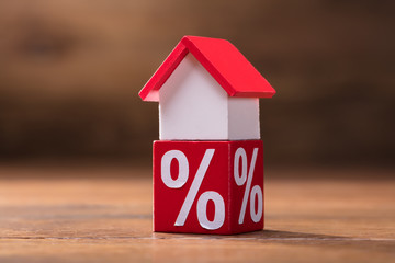 House Model And Percentage Red Block On Table