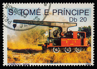 Small locomotive with lifting crane on postage stamp