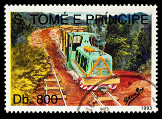 Raylway in the forest with small locomotive on postage stamp
