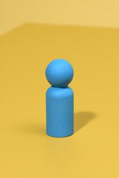 Blue wooden peg doll