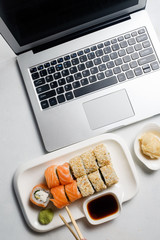 Food blogger lifestyle. Social networks and modern technology concept. Sushi delivery