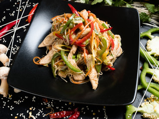 chicken vegetable salad on a plate. traditional asian cuisine food preparation craft