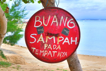 """BALI, INDONESIA. 2018 Feb 2nd. """"Don't waste garbage"""" Sign written in Indonesian, At Sanur Beach"""