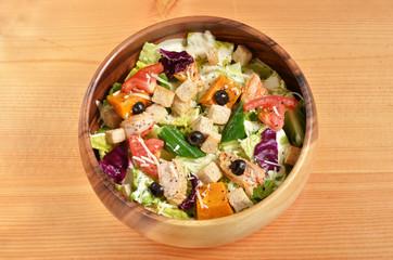 Bowl of delicious and healthy caesar salad