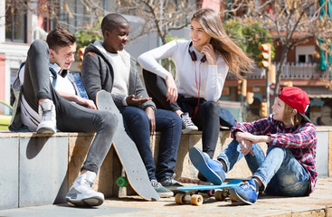 Group of  teenage friends relaxing and chatting