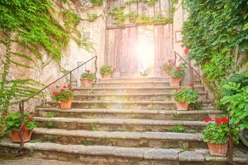 entrance to old european garden at sunset
