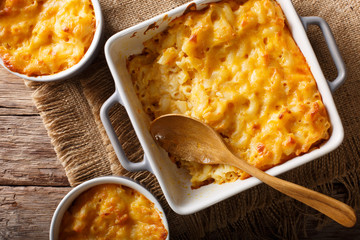 Delicious and hearty meal: casserole mac and cheese in a baking dish close-up. horizontal top view