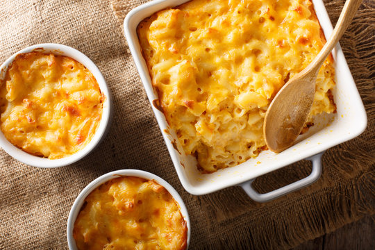 Delicious mac and cheese in a baking dish close-up on a table. horizontal top view