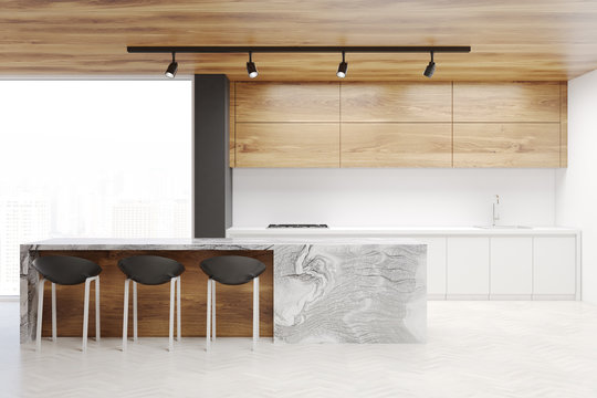 White and wooden kitchen interior with a bar