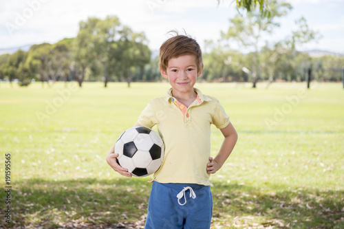 young little kid 7 or 8 years old enjoying happy playing