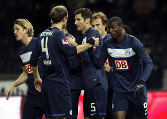 Hertha Berlin's Adrian Ramos celebrates with team mates after scoring against Schalke 04 during the German Bundesliga soccer match in Berlin