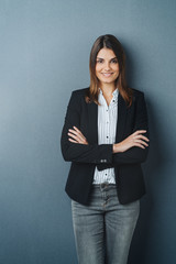 Confident relaxed young professional woman