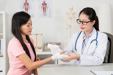 professional beauty lady doctor using bandage