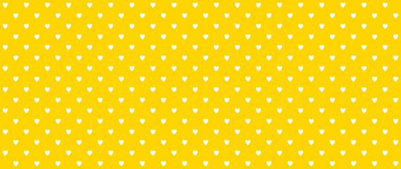 Weiße Herzen auf orangem Hintergrund