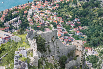 Photo sur Plexiglas Fortification Aerial view from walls of St John Fortress in Kotor with Dobrota town on background, Montenegro