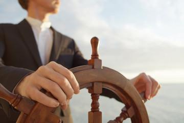 Captain. Hands on ship rudder.
