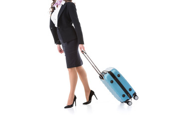 cropped image of stewardess walking with suitcase isolated on white