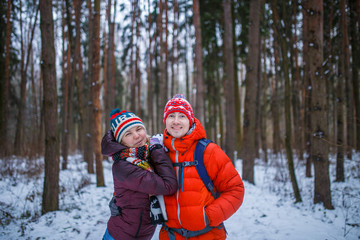 Image of happy couple on walk in winter forest