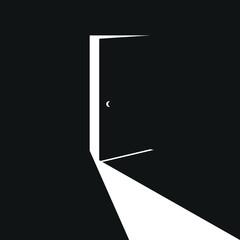 slightly open black door with white light