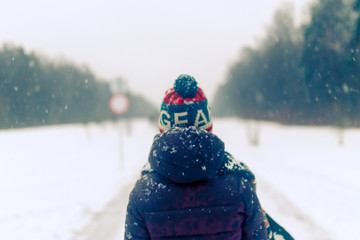 Photo from back of woman with backpack in winter