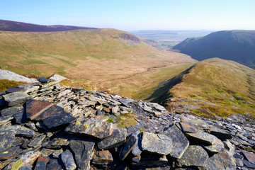 Looking down a ridge towards Bannerdale from Bannerdale Crags, Bowscale Fell in the English Lake District, UK.