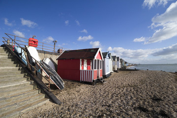 Boats and beach huts on Thorpe Bay beach, Essex, England
