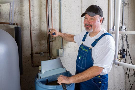 Friendly workman working on a water softener