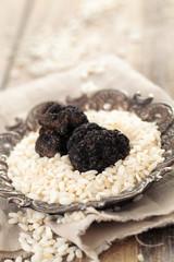 Black truffles and white rice.
