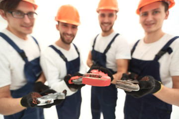 image of a group of builders with gas keys