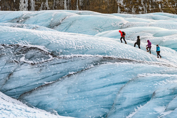 Stores photo Glaciers mountaineers hiking a glacier at vatnajokull, iceland
