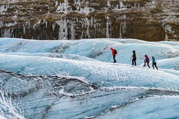Poster Glaciers mountaineers hiking a glacier at vatnajokull, iceland