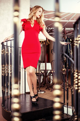 Beautiful blond woman red close-fitting dress