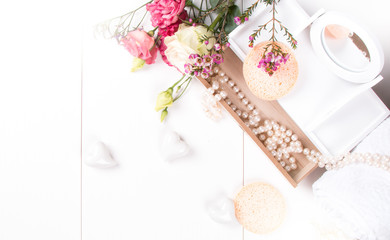 Romantic pack of jewely with flower and perl on wooden background.