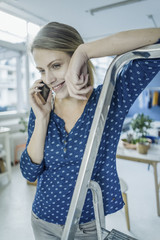 Portrait of smiling young woman on the phone