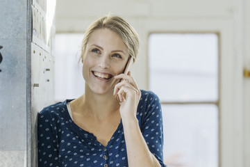 Portrait of happy young woman on the phone