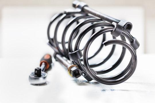 repair of the suspension car. replacing shock absorber spring