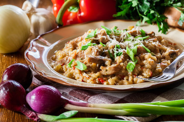 Risotto with champignon mushrooms, pork and parmesan