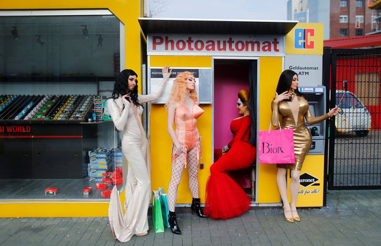 Show dancers of Friedrichstadt-Palast dressed as Divine, Kim Kardashian, Madonna and Conchita Wurst pose during a press event at a photo booth in Berlin