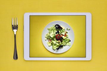 green salad in a digital tablet