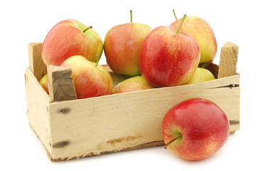 """fresh """"Sissi red"""" apples in a wooden crate on a white background"""