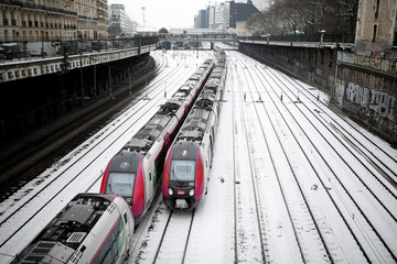 Trains of French state-owned railway company SNCF and railroad tracks are seen at Pont-Cardinet railway station in Paris