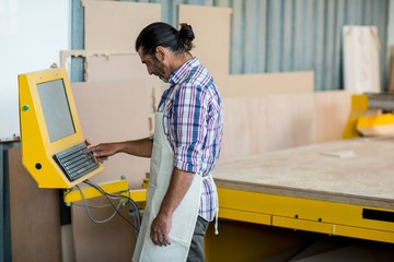 Carpenter pressing controls of engraving machine
