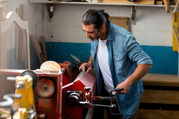 Carpenter working with machinery