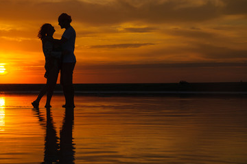 silhouettes of a loving couple at sunset . the concept of love and romance. Card for Valentine's day.