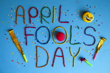 Funny font first april fools day written in plastecine of different colors. Wall mural