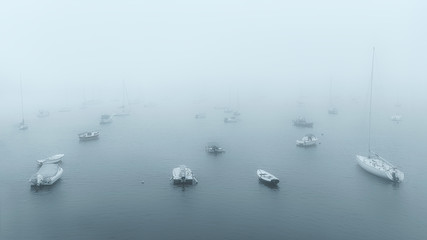 boats in port at foggy morning