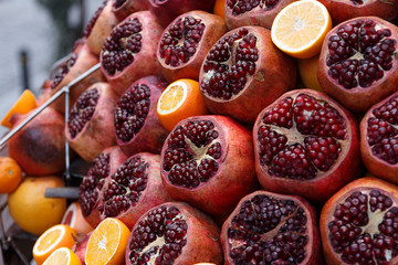Ripe pomegranates and oranges lie on the counter of the street market in Istanbul
