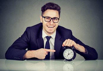 Cheerful businessman managing timetable